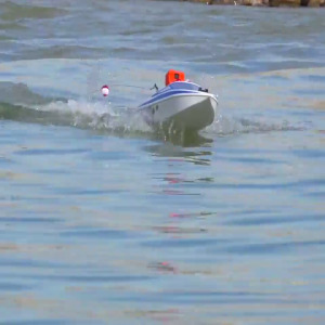 Watch this guy land a pike with an RC Boat